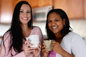 Two women holding mugs